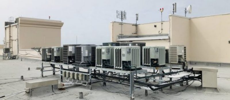 air conditioning units on roof of a high rise condominium building