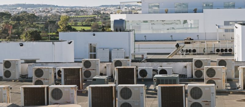 industrial air conditioning and ventilation units on rooftop building